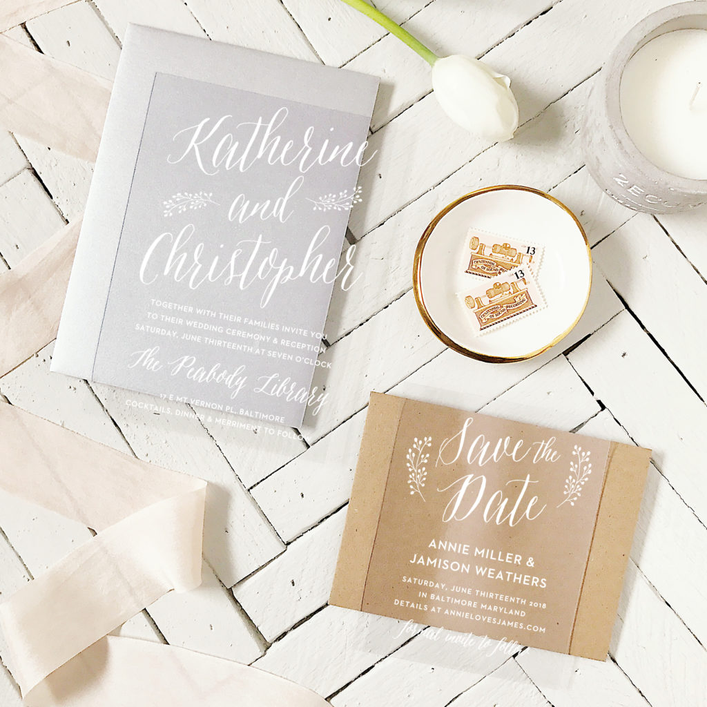 clear vinyl wedding invitation suite from Basic Invite on styled chevron wood background